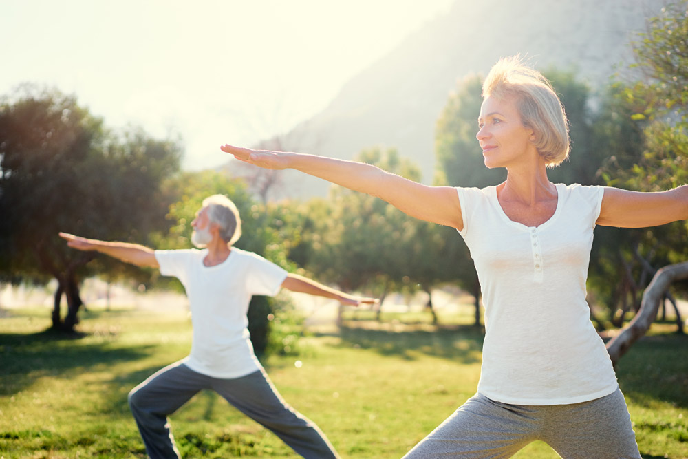 older-couple-doing-yoga-in-park